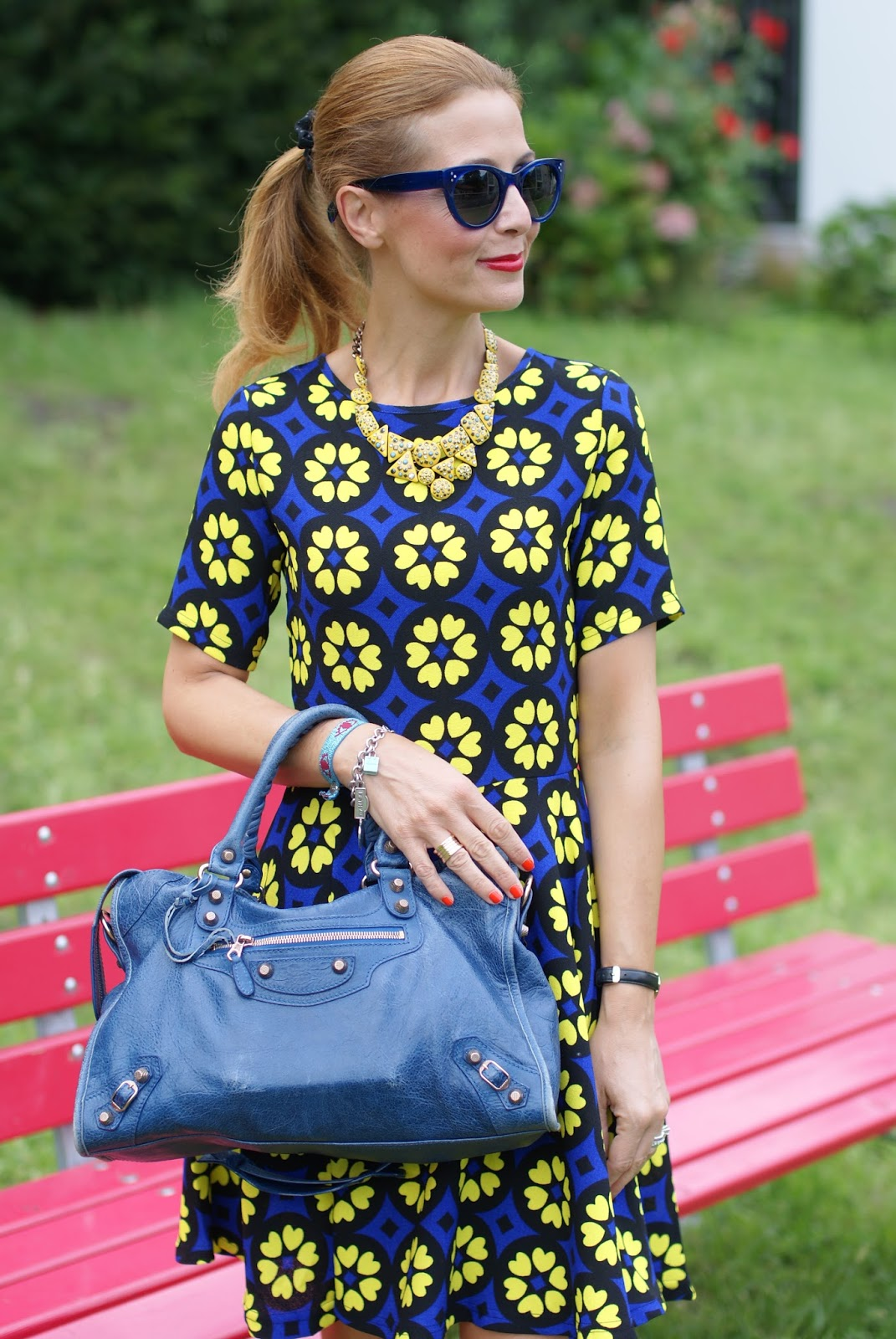 Daisy print skater dress with adidas Supercolor yellow sneakers on Fashion and Cookies fashion blog, fashion blogger girly style