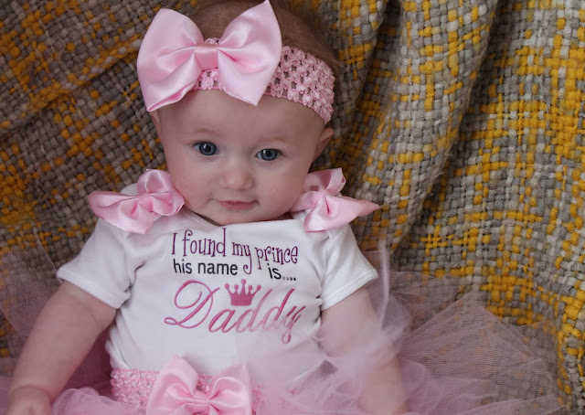 baby wearing father's day top with pink tutu and pink headband