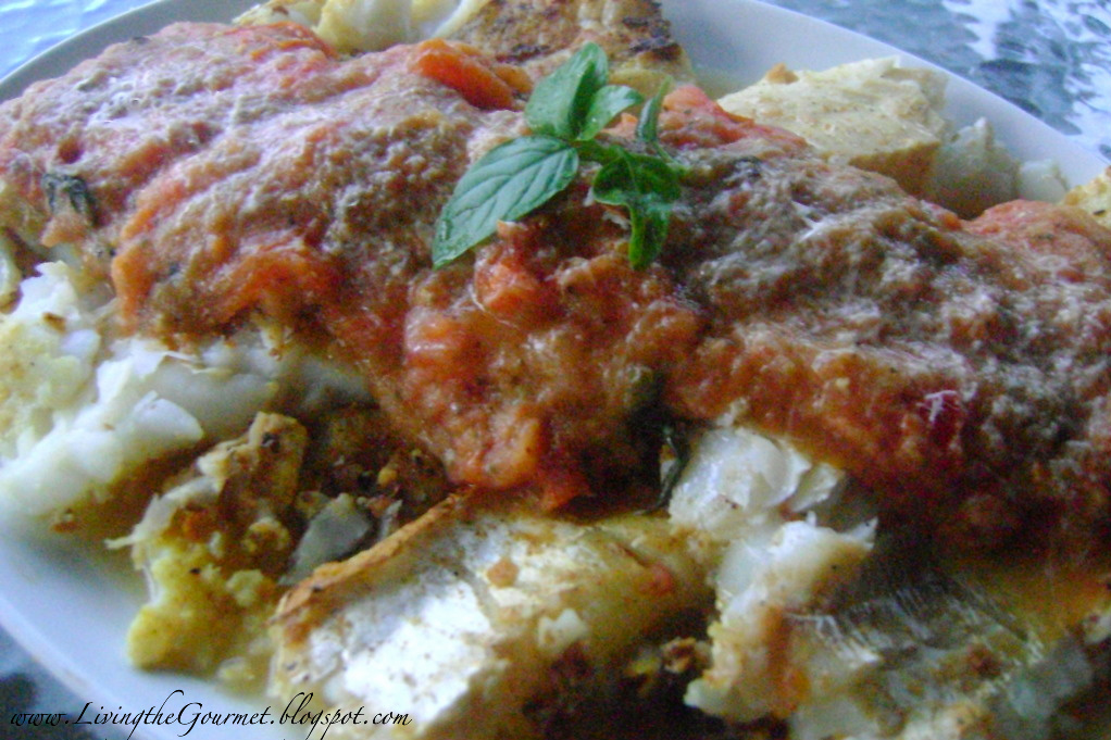 Grilled cod fish filet with creamy tomato sauce for Grilled cod fish recipes