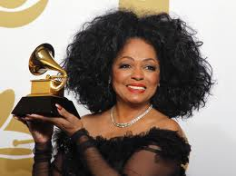 Photo of Diana Ross holding her Grammy
