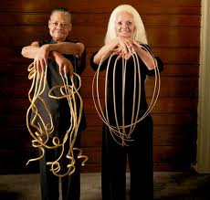 Longest fingernail holding Man and Woman together