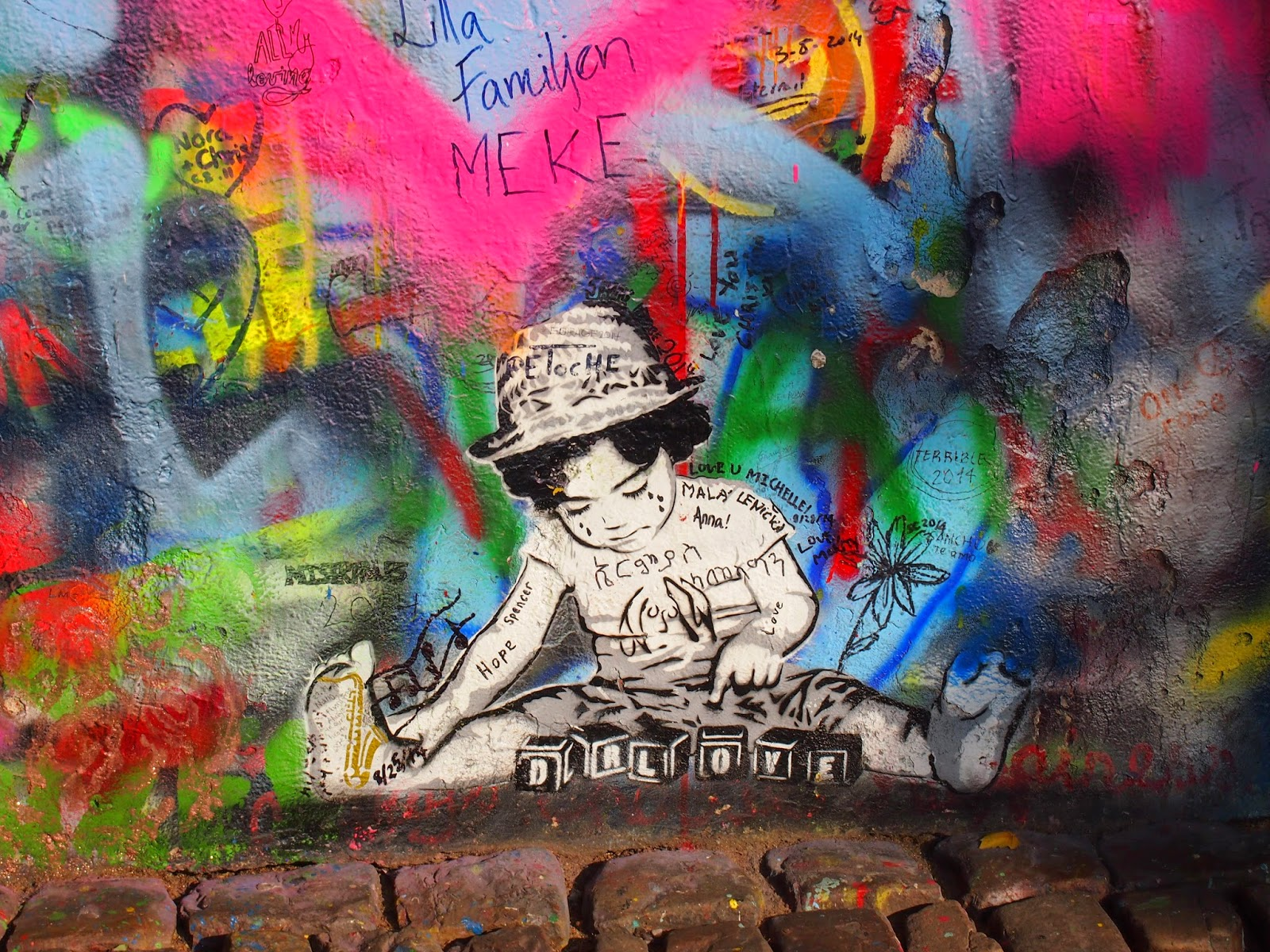 A painting of a child at the Lennon Wall