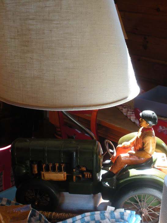 THE TRACTOR LAMP SAT ON THE KITCHEN ISLAND..