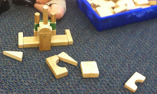 Building with wooden blocks (Brick by Brick)