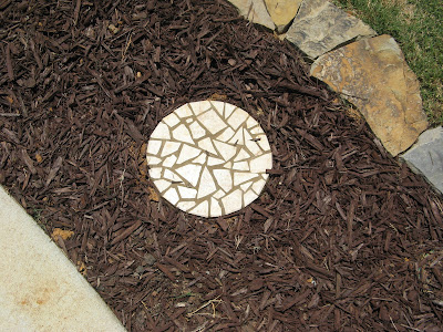 Mosaic Stepping Stones in Garden Bed