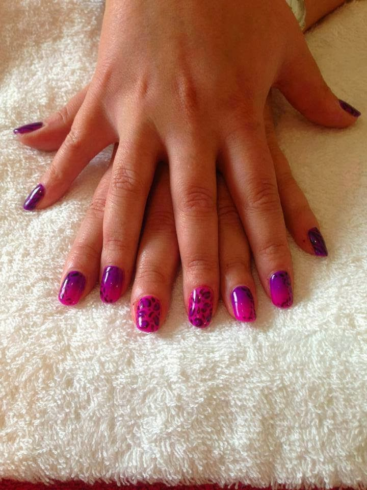 Hot pink and purple ombre fade on natural nails and cheetah prints