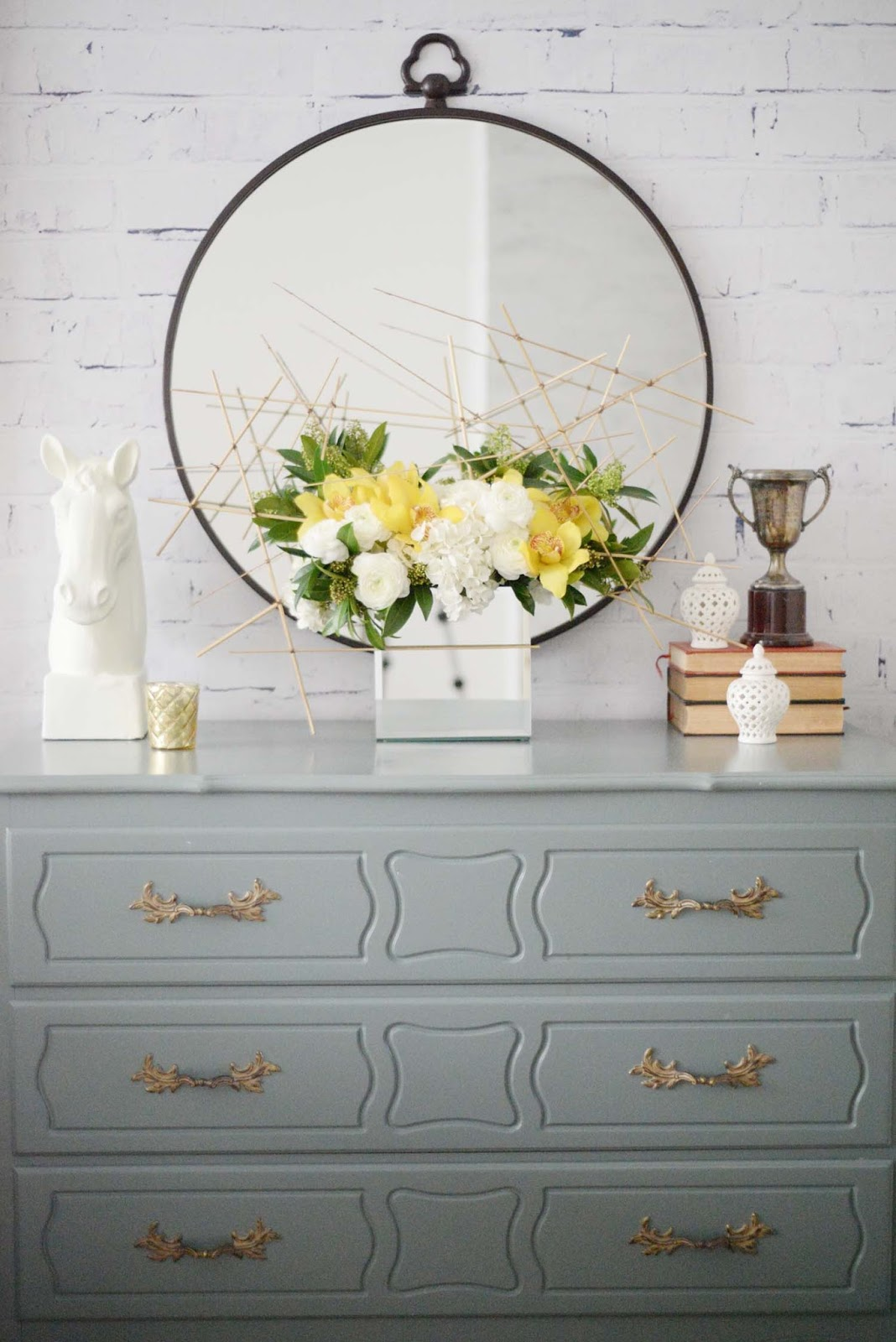 Wayfair Winter Refresh | Fresh Florals orchid hydrangea ranunculus reed | Round metal mirror | RamblingRenovators.ca