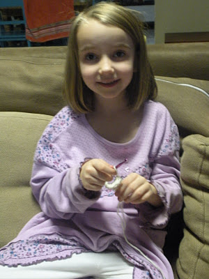 kid learning to crochet