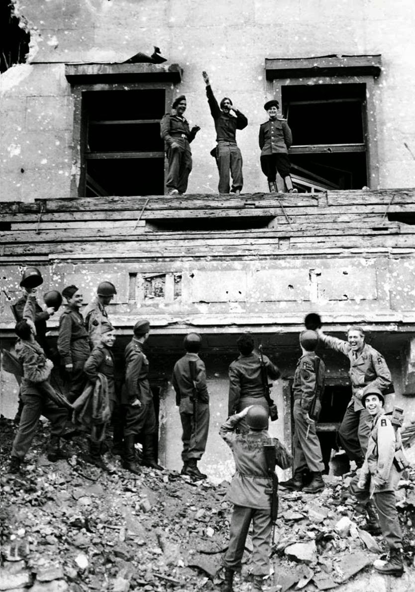 Soldiers mock Hitler atop his balcony at the Reich Chancellery, 1945