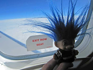 Troll flying in an airplane