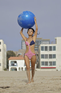 Bai Ling holding a blue yoga ball