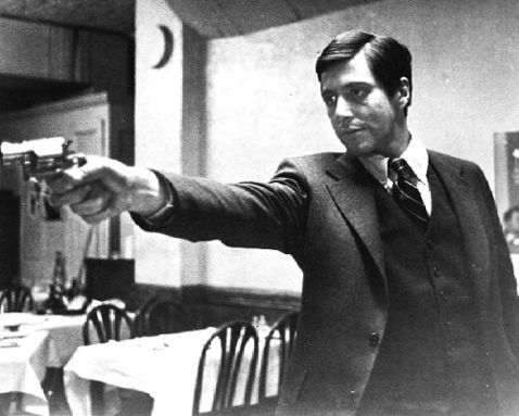 Al Pacino firing a gun in The Godfather  movieloversreviews.filminspector.com
