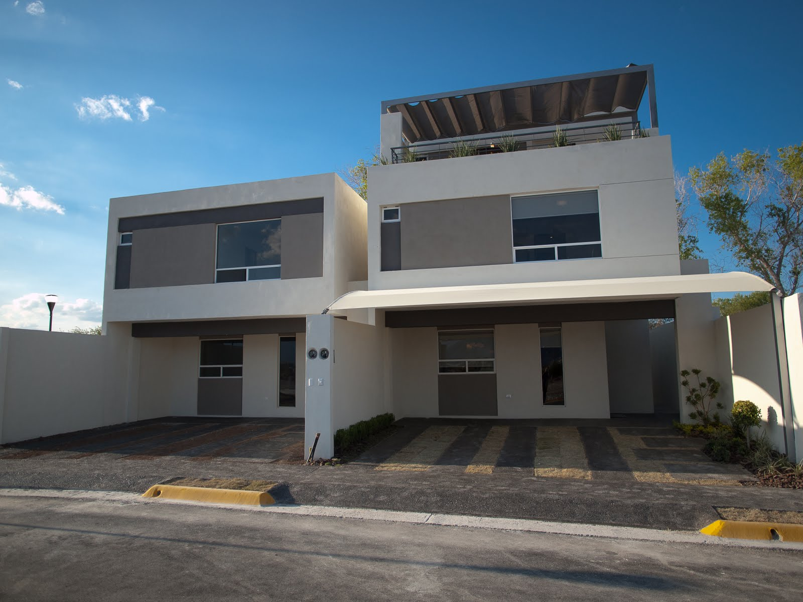 Fachadas contempor neas septiembre 2012 for Fachada de casas modernas con porton