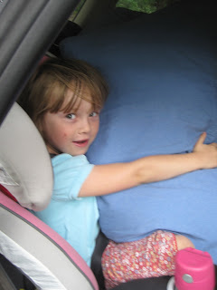 Girl in carseat with pillow