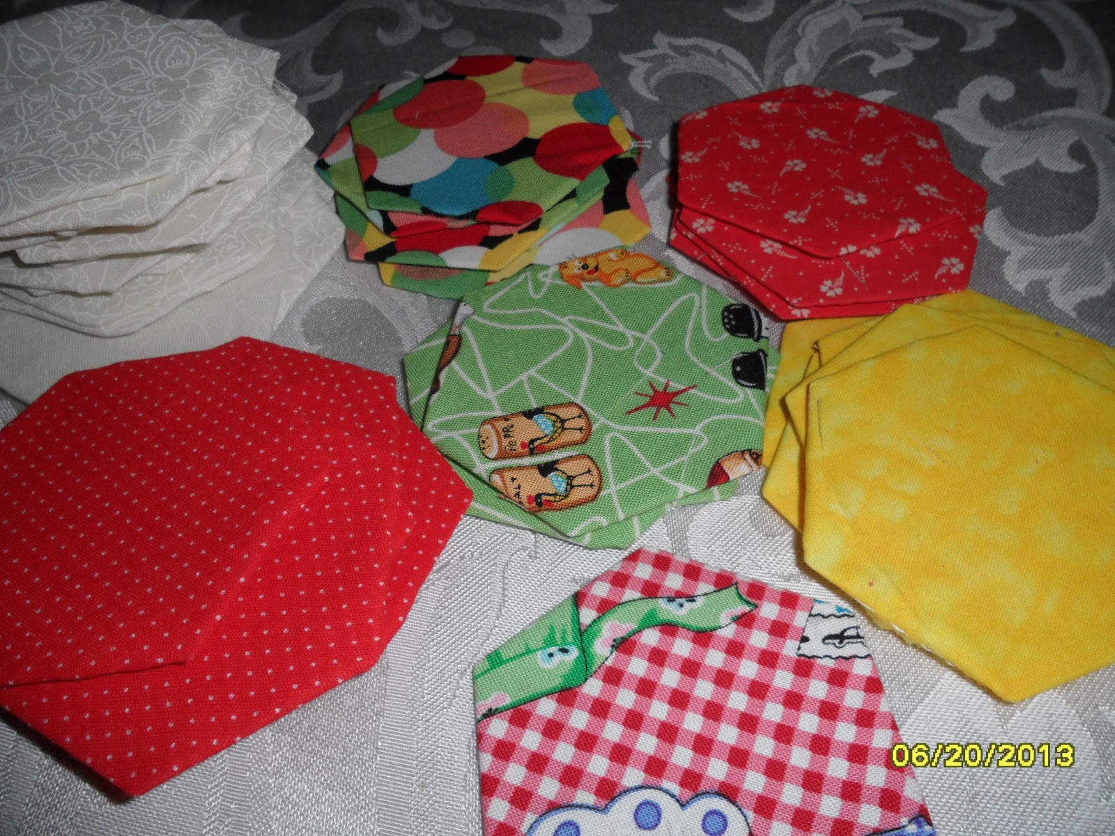 In sewtopia the hexagon english paper piecingplastic piecing i cut a paper template 14 inches larger than the plastic template with the pattern provided in the kit i backed that paper template with a piece of fine maxwellsz