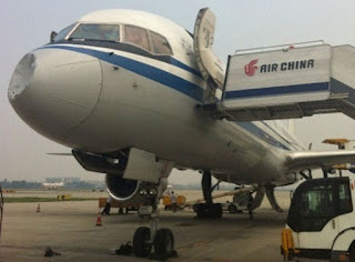 Damaged nose cone on Air China Boeing 757