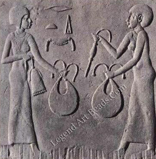 Limestone relief in archaizing style showing women carrying collars, a counterpoise and a sweret-bead necklace. 4th Cent. BC. Cairo Museum