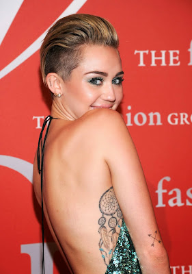 Miley Cyrus Looks Elegant Backless at 30th Annual Night of Stars Galaxy