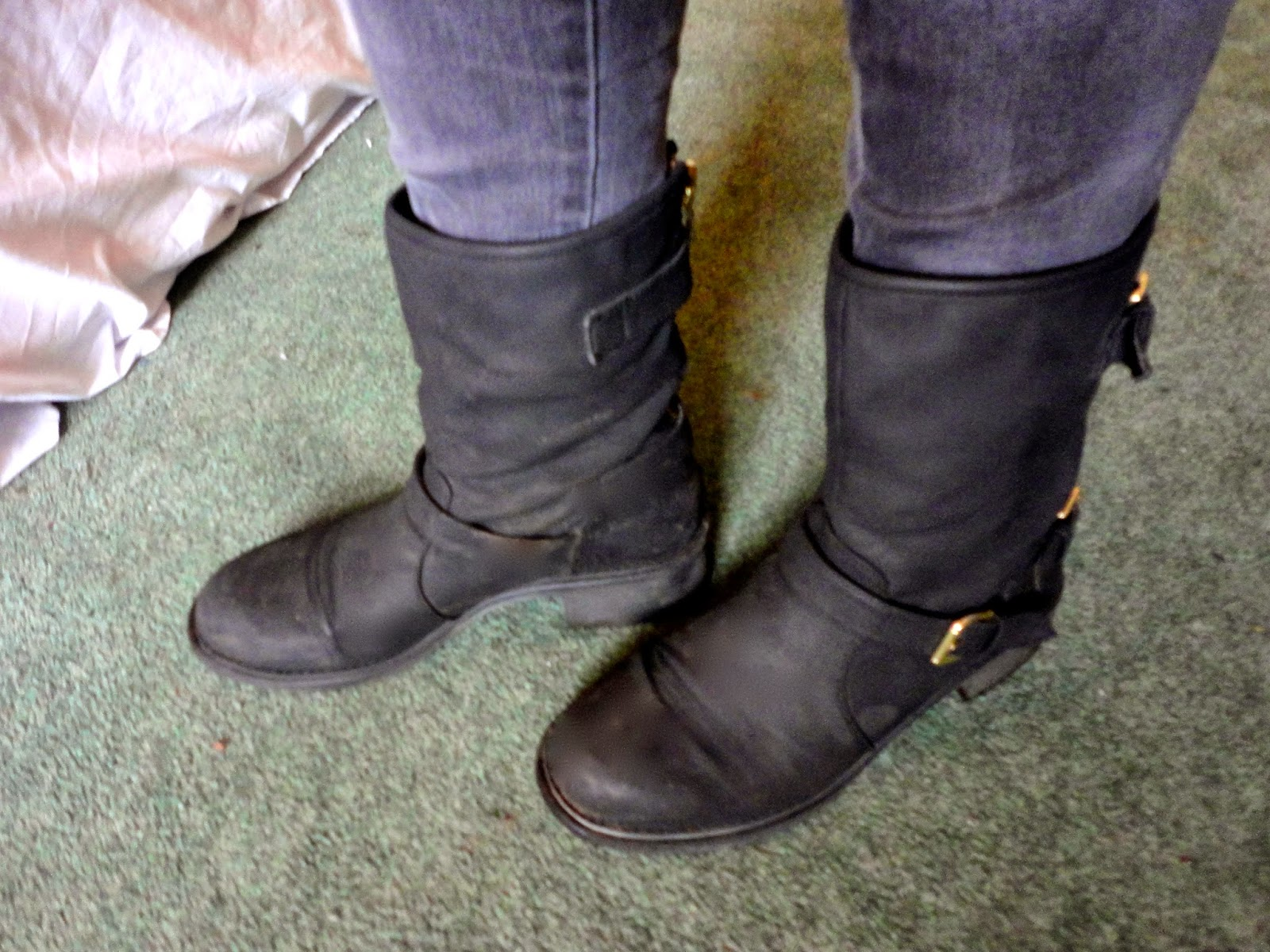 Black biker boots with grey skinny jeans