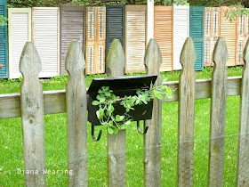 One cool repurposed shutter and old door fence - Diana Wearing