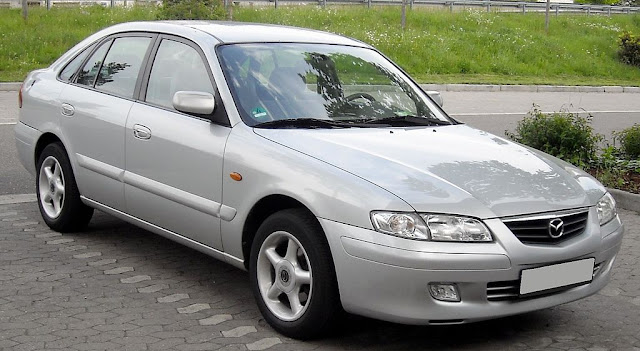 Side image of grey Mazda 626 vehicle