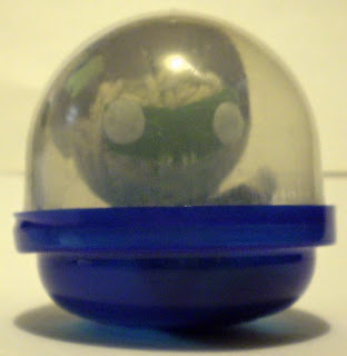 Mini Green Lantern string puppet in vending machine plastic capsule