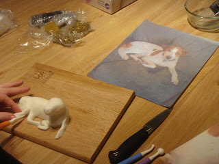 Fondant Dog sculpture with model picture