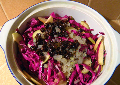 Cabbage Salad with Dressing, Onion, and Raisins on top ready to microwave