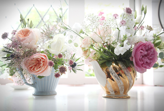flowers in vintage teapots
