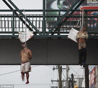 drug gangs hang rival members from city center bridge