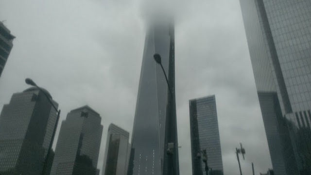 the 9/11 memorial on a rainy day