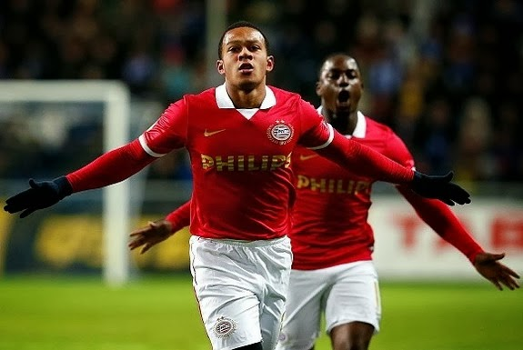 PSV player Memphis Depay celebrates after scoring the opening goal against Chornomorets