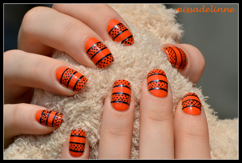 Orange and Black Nail Designs http://www.missadelinne.com/2012/06/orange-black.html