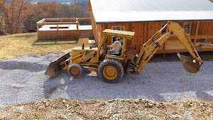 George working on his new driveway