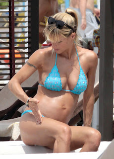 Michelle Hunziker spotted in a blue bikini poolside in Forte dei Marmi