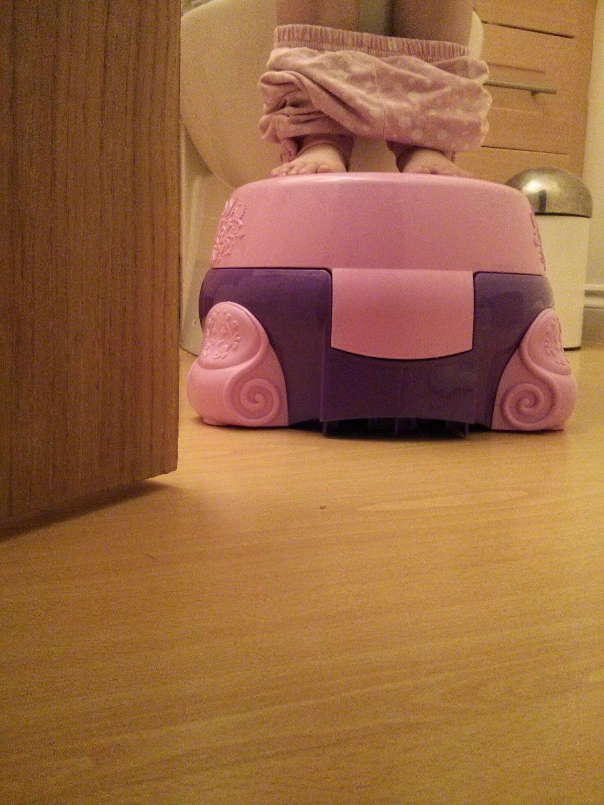 Using Disney Princess potty as step