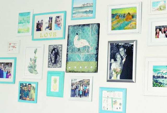 blue green gallery wall