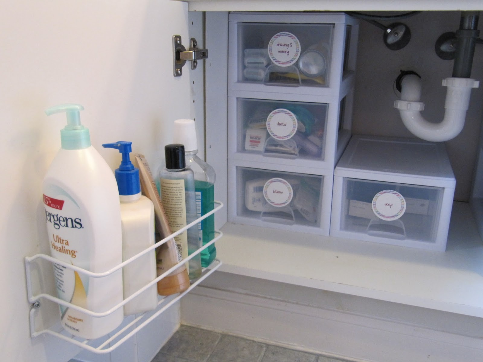 Everyday organizing making the most of under your for Bathroom under sink organizer