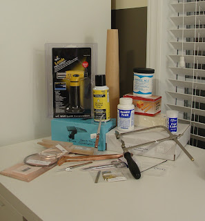 supplies to begin metalsmithing in Vicky's house including a Lenk Torch, bench pin, Dapping block, jeweler's saw and more