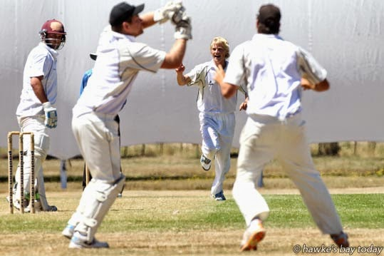 L-R: Robbie Spears, Wairarapa Bush, caught by Scott Schaw, wicket-keeper; Christian Leopard, bowler - cricket at Onga Onga, Central Hawke's Bay. photograph