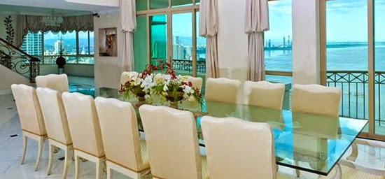 The dining room of this luxury condo with views of Panama City