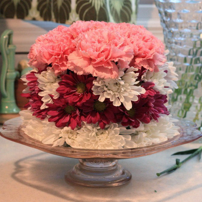 Erins art and gardens diy flower cake pretty at this point i decided to transfer my flower cake to a different more sparkly silver cake stand and i changed the rows of flowers slightly mightylinksfo Choice Image