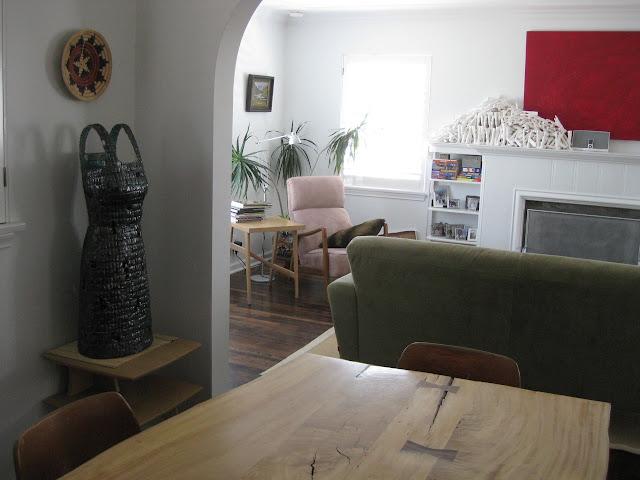 Jen Harmon Allen leg installation  and dress in home of Foster Art Patron