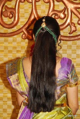 Bride in ponytail hairstyle for marriage reception.