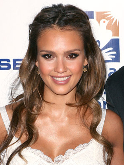 This half-up, half-down hairstyle shows off Jessica Alba's glowing complexion and caramel brown hair perfectly.