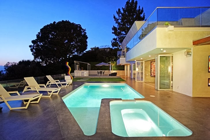 Backyard of Modern Beverly Hills House with open interiors at night