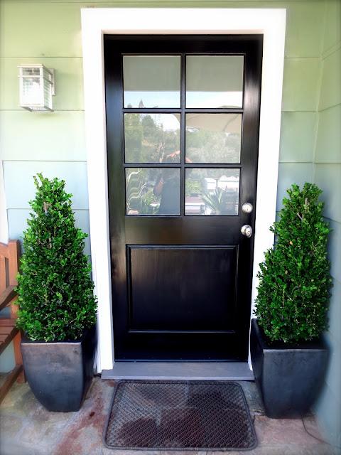 black front door Nbaynadamas boxwood topiary topiaries plants modern pots planters wire doormat