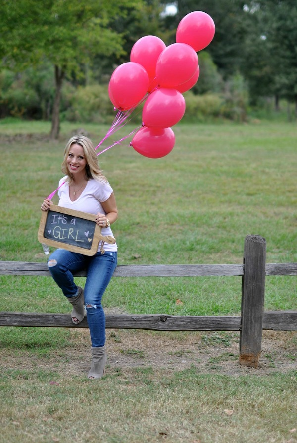 Gender reveal idea - It's a Girl with pink balloons and chalkboard sign