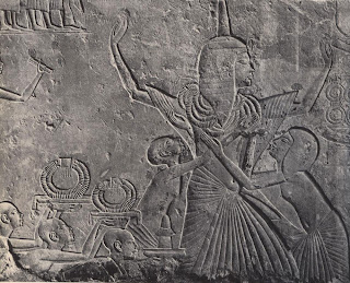 Limestone relief from the Saqqara tomb of liar-em-hab showing him is receiving many gold collars of honour from the King.