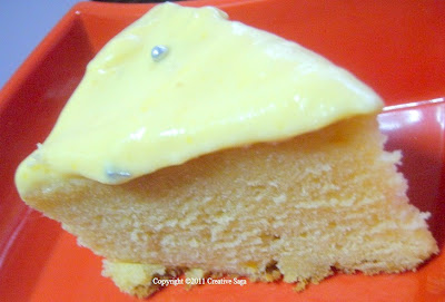 slice of mango cake with mango cream frosting
